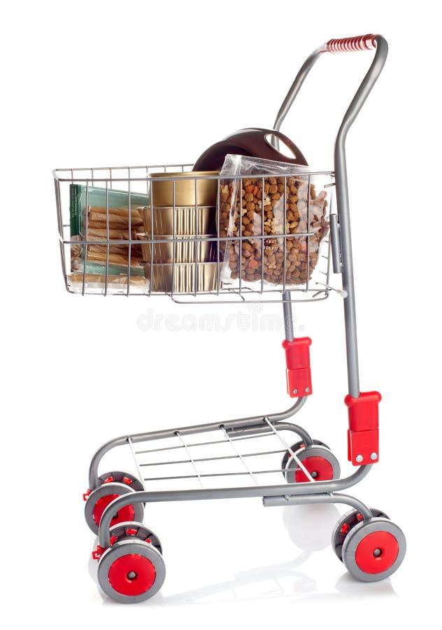 Sshopping cart full of dog food. On white background stock photos