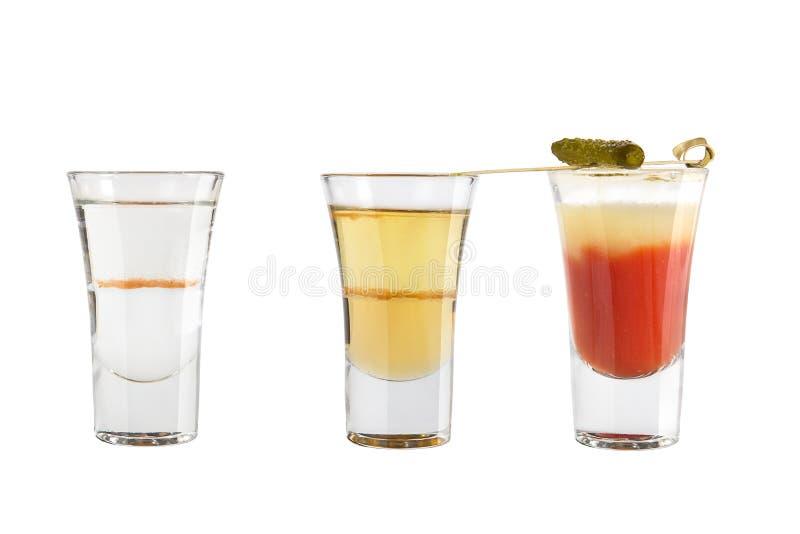 Ställ in av alkoholskott på en vit bakgrund Tre olika skott royaltyfri foto