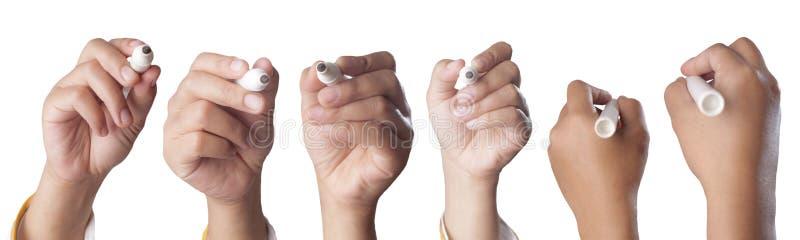 Ställ in av händer som skriftligen rymmer position för markör fotografering för bildbyråer