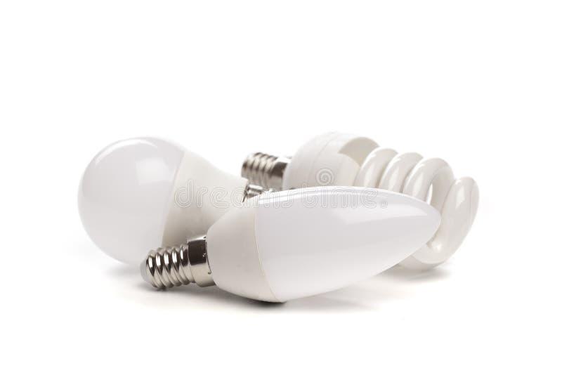 Ställ in av LED ny teknik för den ljusa kulan som isoleras på vit bakgrund, energi - sparande elektrisk lampa royaltyfri bild
