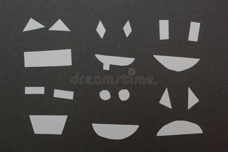 Ställ in av pappers- leenden på en grå bakgrund stock illustrationer