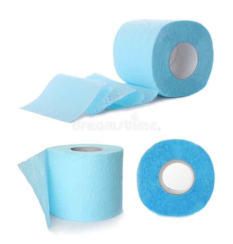 Ställ in av pappers- rullar för toaletten arkivbilder