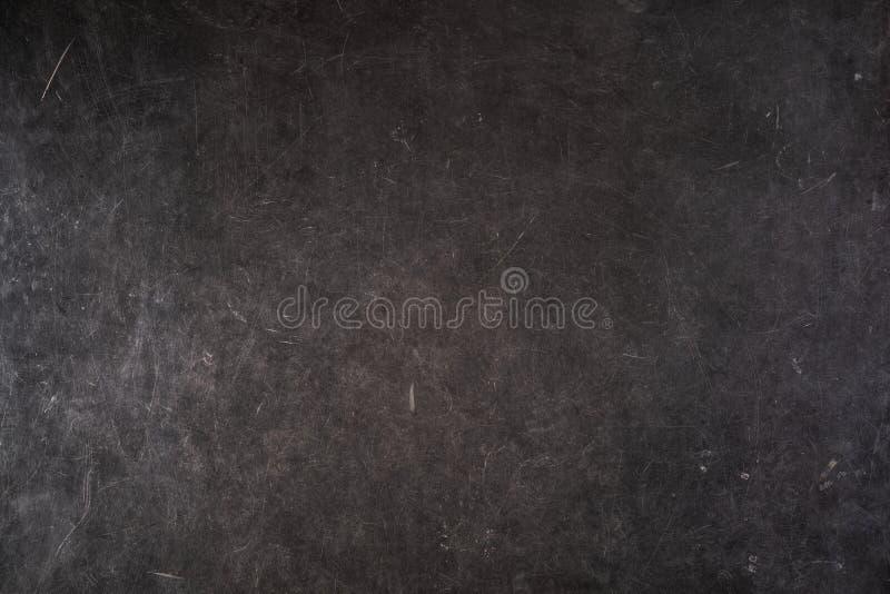 Ställ in av skrapor på en grå grungy yttersida royaltyfri bild
