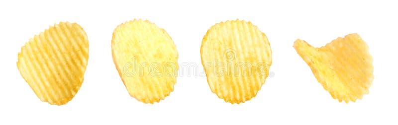 Ställ in av smakliga ridged potatischiper arkivfoto