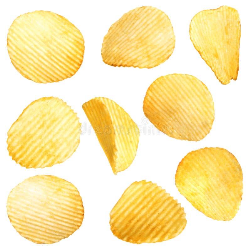 Ställ in av smakliga ridged potatischiper på vit fotografering för bildbyråer