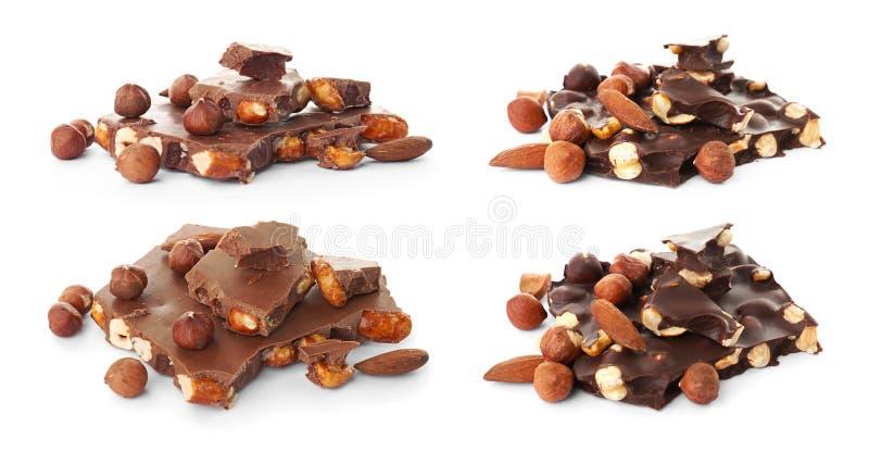 Ställ in med olika sorter av läcker choklad och muttrar royaltyfri bild