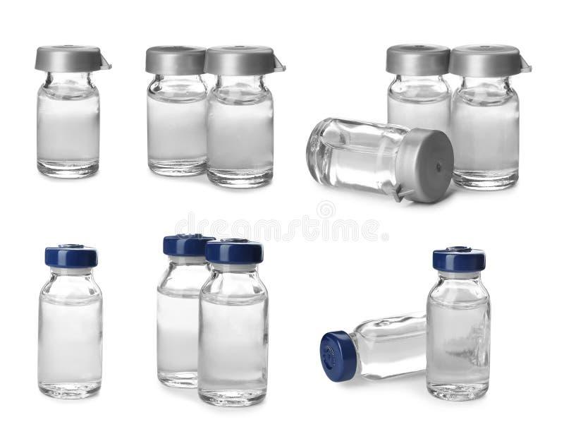 Ställ in med små medicinflaskor av lösningen för injektion på vit bakgrund royaltyfri fotografi