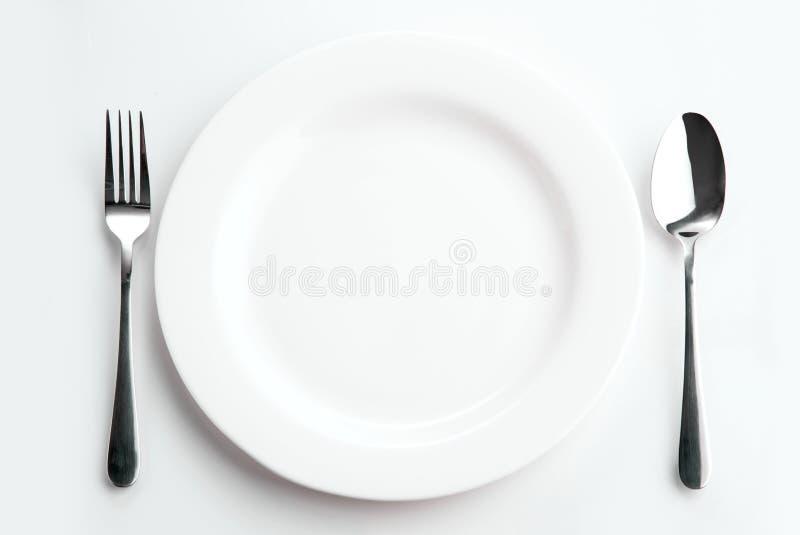 Ställeinställning med plattan, skeden och gaffeln fotografering för bildbyråer