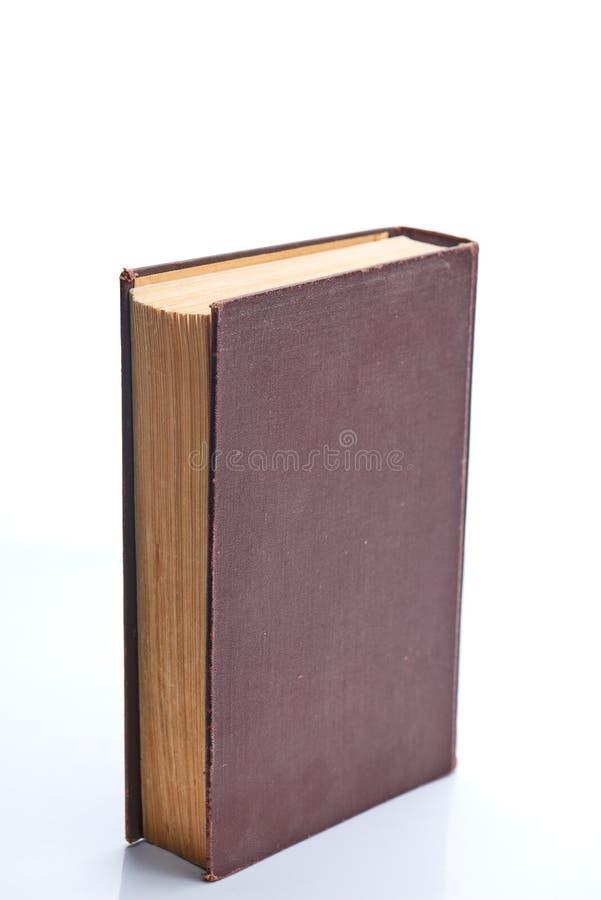 Ställningar för gammal bok på vit royaltyfria foton