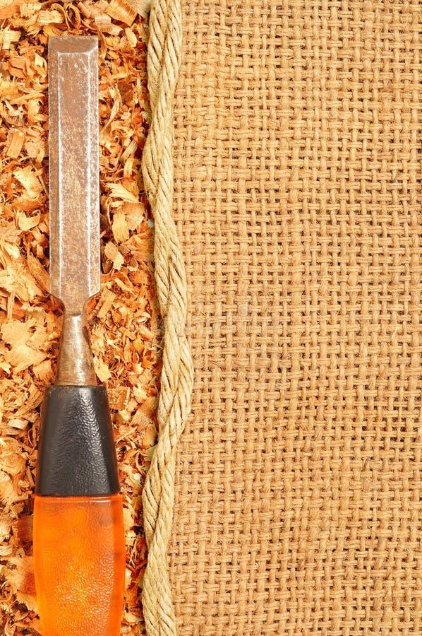 stämjärnet flagar gammalt travt sawduststål arkivbild