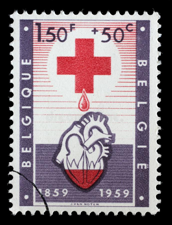 Stämpel från Belgien som illustrerar Röda korset royaltyfri foto