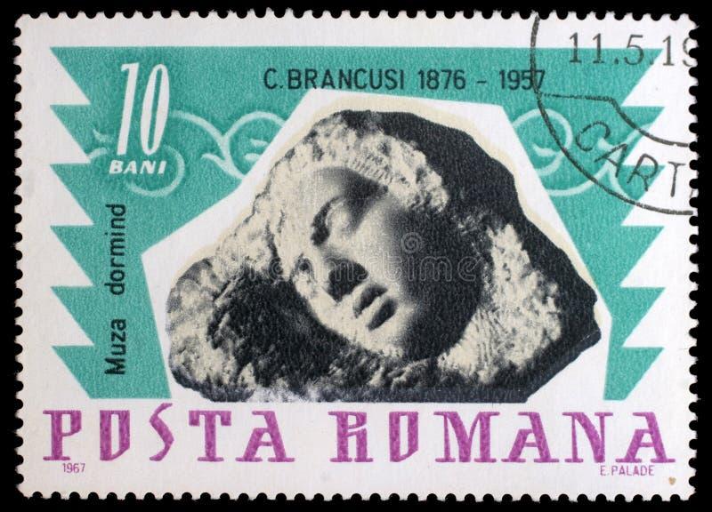 Stämpel som skrivs ut i Rumänien shower som sover musa av Constantin Brancusi arkivbilder