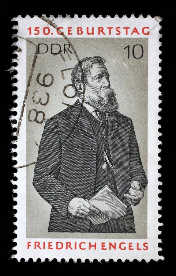 Stämpeln som skrivs ut i GDR, visar Friedrich Engels royaltyfri bild