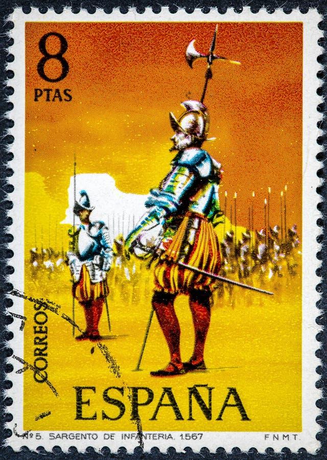 Stämpeln som skrivs ut i Spanien, visar sergeanten av infanteri 1567 royaltyfri fotografi