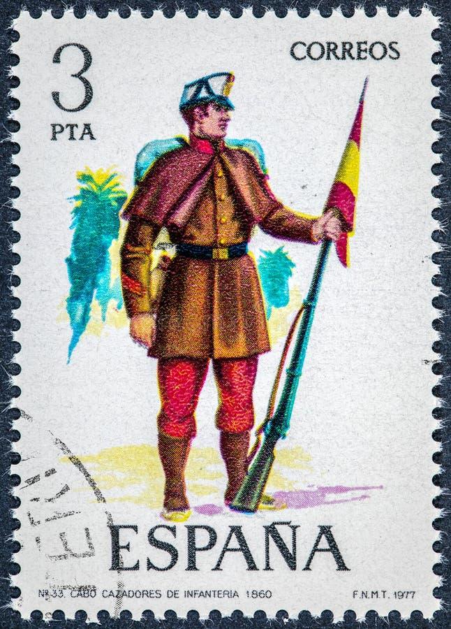 Stämpeln som skrivs ut i Spanien, visar uddejägare av infanteri 1860 royaltyfria bilder