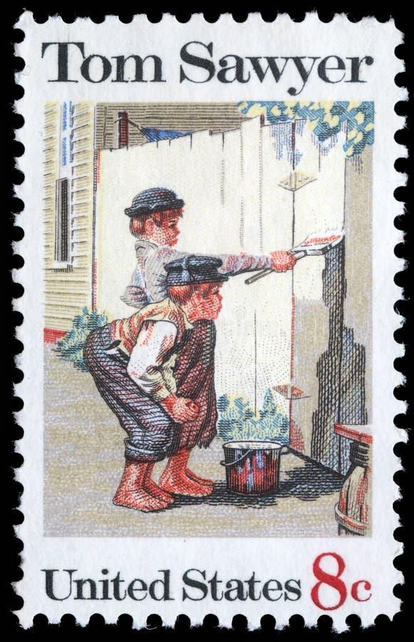 Stämpeln som skrivs ut i USA, visar den målning`-Tom Sawyer `en, vid Norman Rockwell royaltyfria foton