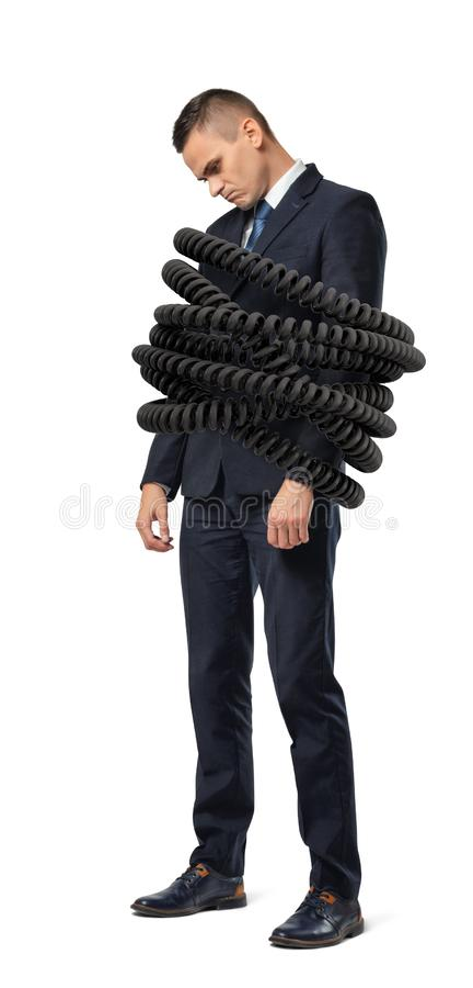 Stände eines traurige junge Geschäftsmannes fest gesprungen durch große Telefonschnüre auf einem weißen Hintergrund lizenzfreie stockbilder