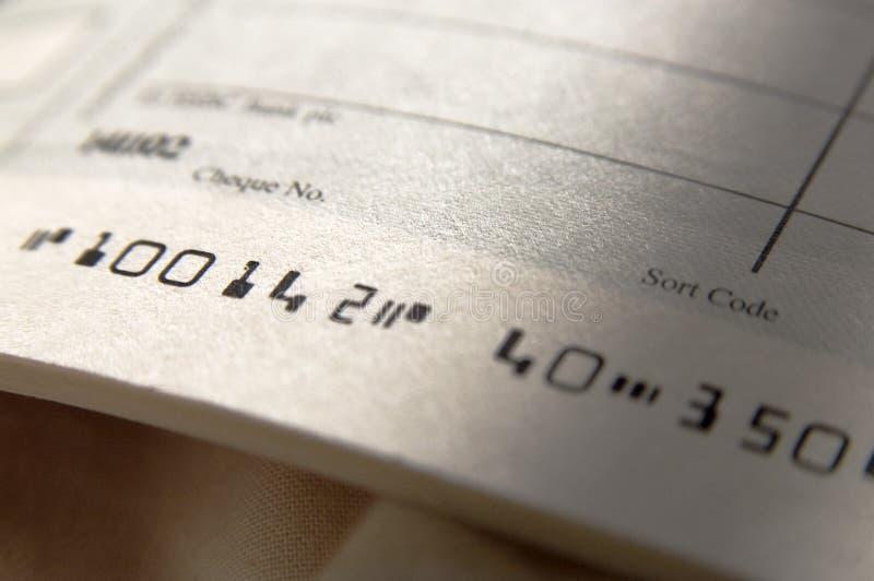 Stäng sig upp av checkboken royaltyfri foto