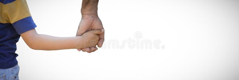 Stäng sig upp av fader- och sonhänder mot vit bakgrund fotografering för bildbyråer