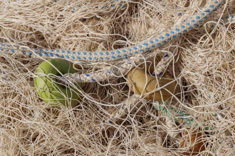 Stäng sig upp av fisknät och rep royaltyfri fotografi