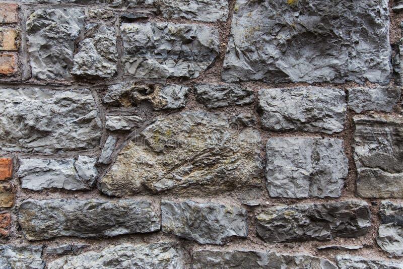 Stäng sig upp av gammal tegelsten- eller stenväggbakgrund royaltyfri bild