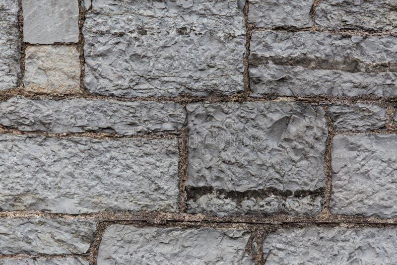 Stäng sig upp av gammal tegelsten- eller stenväggbakgrund royaltyfri fotografi