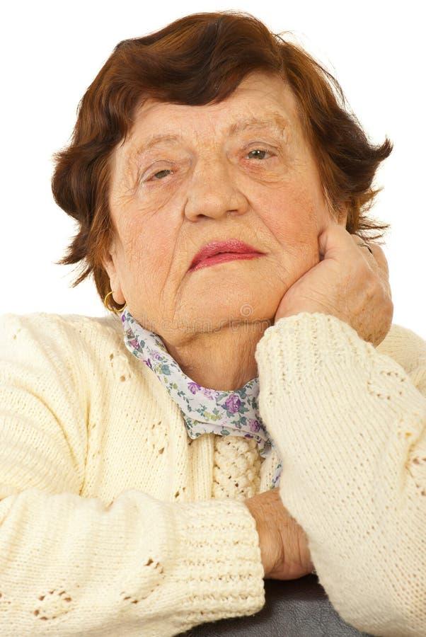 Stäng sig upp av gammalare kvinnaframsida arkivfoto