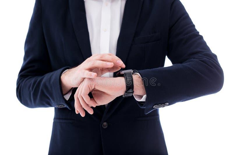 Stäng sig upp av klockan på den manliga handleden som isoleras på vit royaltyfria bilder