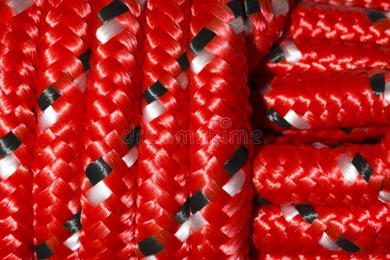Stäng sig upp av rött nylonrep royaltyfri illustrationer