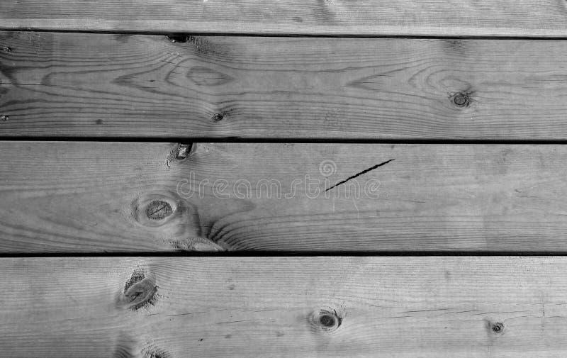 Stäng sig upp på trägolvplankor svart white textur arkivbild