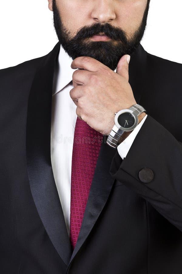 Stäng sig upp ståenden av affärsmannen, medan tänka arkivbild