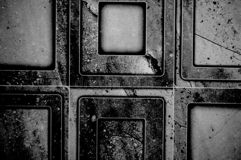 Stäng upp svartvitt av en badrumtegelplattatextur royaltyfri foto