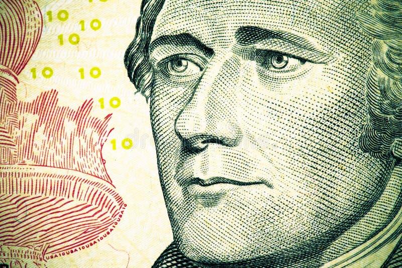 Stäng upp till den Alexander Hamilton ståenden på räkning för dollar tio signal arkivfoton