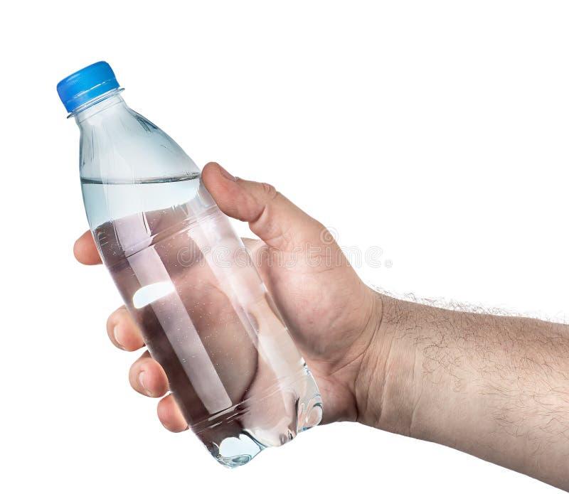 Stängd plast- vattenflaska i hand royaltyfri bild