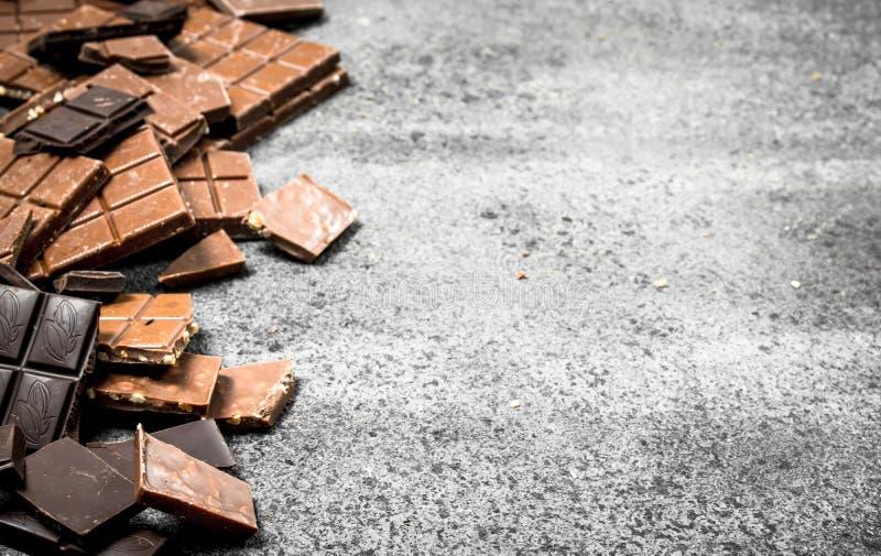 stänger bruten choklad Nolla arkivbild