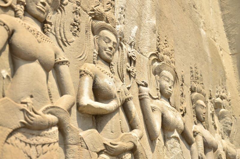 Stängt upp att visa tempelväggen Angkor Wat royaltyfri foto
