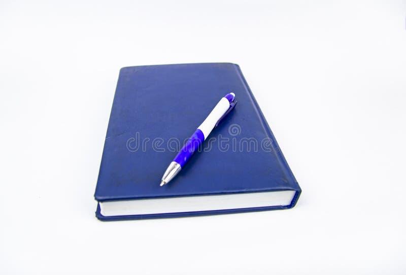Stängt vecko med pennan på en vit bakgrund arkivfoton