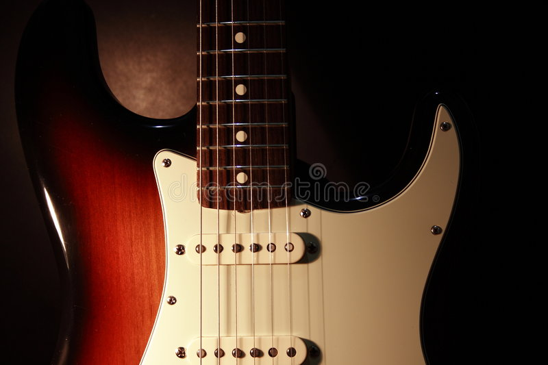 stänkskärmgitarrstratocaster royaltyfria foton