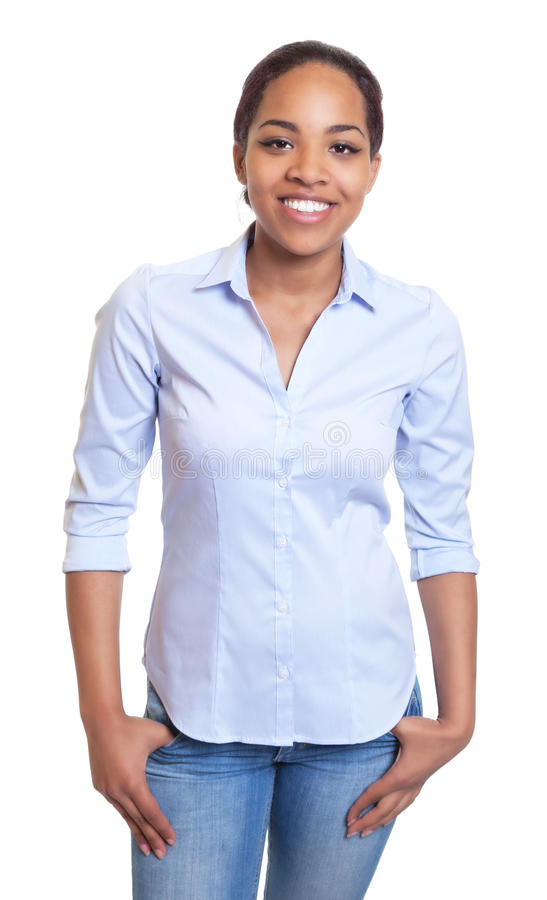 Stående afrikansk kvinna i en blå skjorta arkivfoto