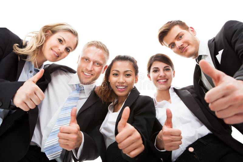 Stående av affärsfolk som gör en gest upp tummar royaltyfria foton