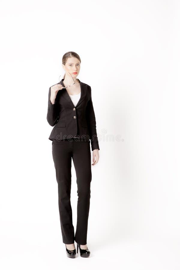 Stående av affärskvinnan med exponeringsglas på en vit bakgrund fotografering för bildbyråer