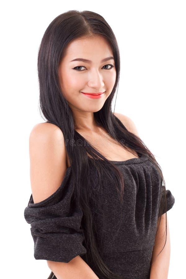 Stående av att le den asiatiska kvinnan arkivfoton