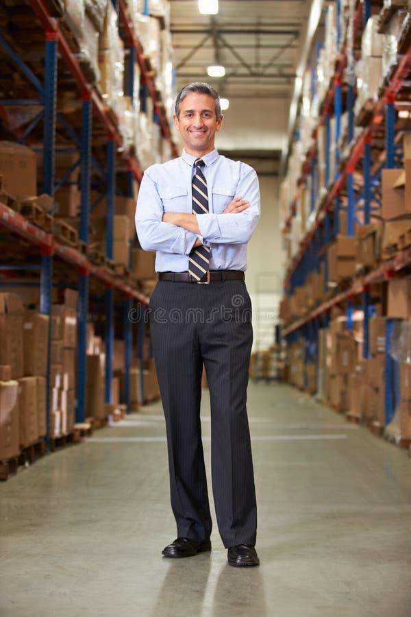 Stående av chefen In Warehouse royaltyfria foton