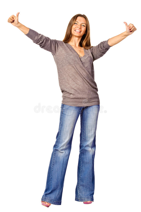 Stående av den älskvärda tonårs- flickan med tum upp royaltyfri fotografi