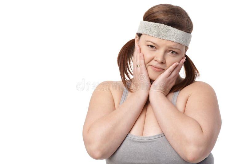 Stående av den besvikna feta kvinnan arkivbild
