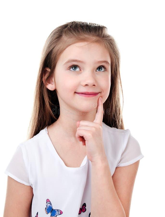 Stående av den förtjusande tänkande lilla flickan arkivbild