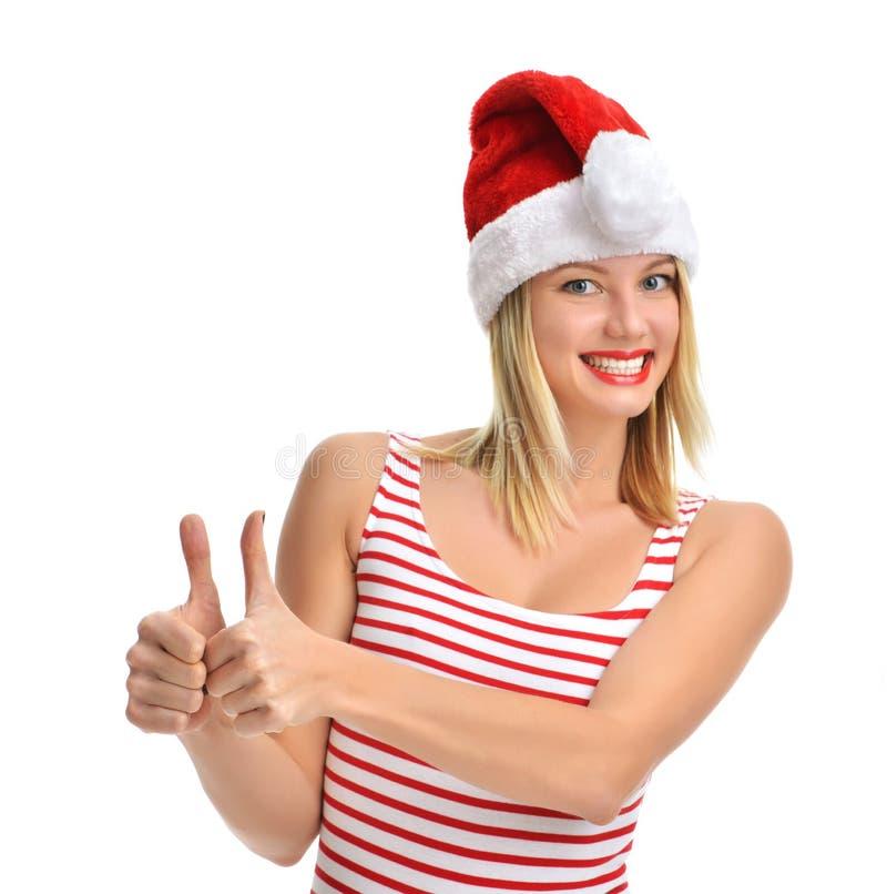 Stående av den glade nätta kvinnan i rött skratta för Santa Claus hatt fotografering för bildbyråer