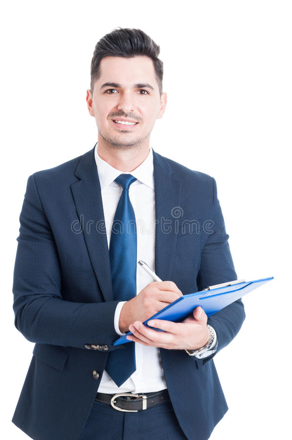Stående av den gladlynta representanten med skrivplattan som tar anmärkningar fotografering för bildbyråer