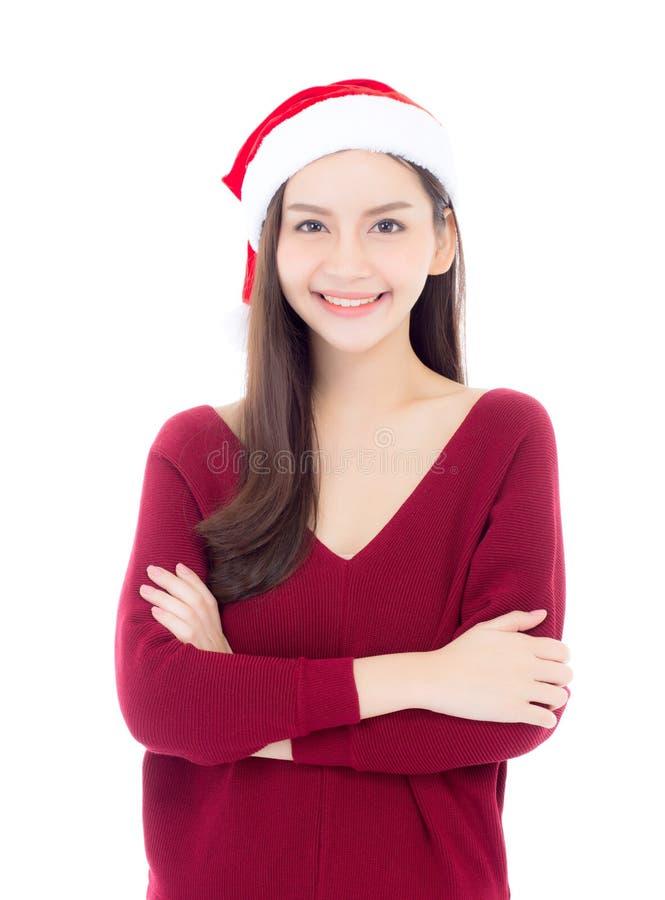 Stående av den härliga asiatiska unga kvinnan med hälsa i den santa hatten arkivbilder