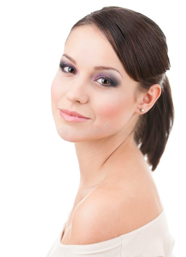 Stående av den härliga kvinnan med makeup royaltyfri foto